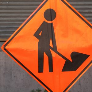 Highway Sign / Persons Working